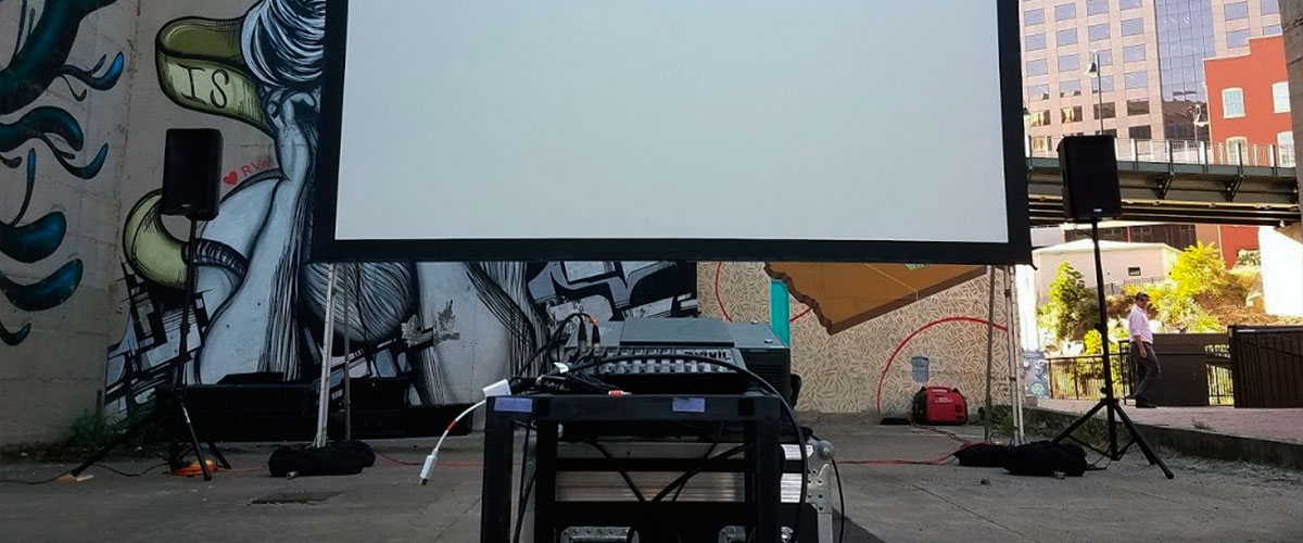 Projector with outdoor speakers